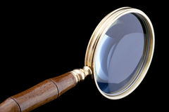 Magnifying glass on black close up Royalty Free Stock Images