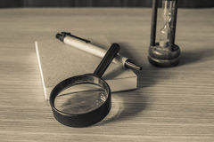 Magnifying glass with black and white. Royalty Free Stock Photo