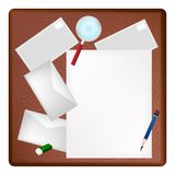 Magnifying Glass on Blank Page and Envelope Royalty Free Stock Photography