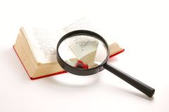 Magnifying glass and book Royalty Free Stock Image