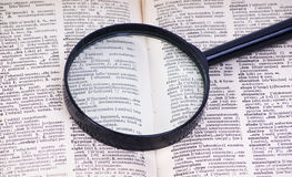 Magnifying Glass On Book. Royalty Free Stock Images