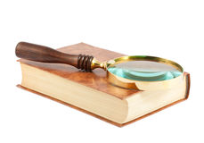 Magnifying glass on the book Royalty Free Stock Photography