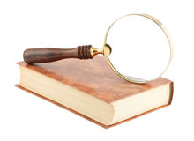 Magnifying glass on the book Stock Photography