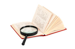 Magnifying glass and book Stock Images