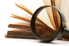 Magnifying glass and book Stock Photography
