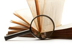 Magnifying glass and book Royalty Free Stock Photo