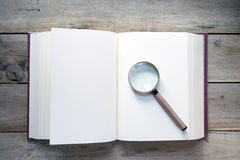Magnifying glass and book Stock Photo