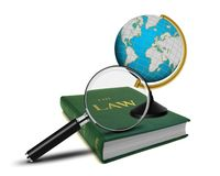 Magnifying Glass and the Book of Law. With Globe Stock Image