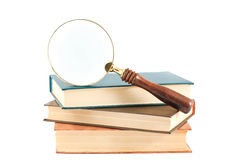 Magnifying glass and books Royalty Free Stock Photos