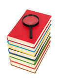Magnifying glass and books Royalty Free Stock Image