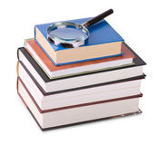 Magnifying glass on books Royalty Free Stock Images