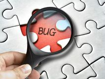 Magnifying glass on bug that is a mssing tile of the puzzle Stock Photo