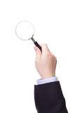Magnifying glass in business man hand Royalty Free Stock Image