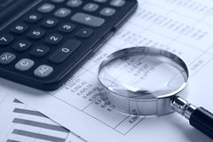 Magnifying glass with calculator Royalty Free Stock Photos