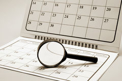 Magnifying Glass on Calendar Stock Images