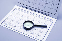 Magnifying Glass on Calendar. In Blue Tone Stock Image