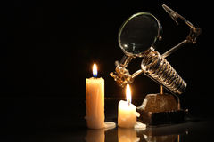 Magnifying Glass And Candles Stock Photos