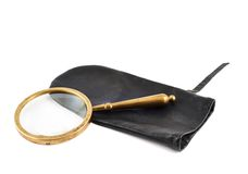 Magnifying glass in a case Royalty Free Stock Photos