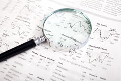 Magnifying glass and chart Royalty Free Stock Photos