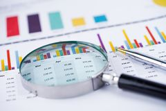 Magnifying glass on charts graphs spreadsheet paper. Financial development, Banking Account, Statistics, Investment Analytic research data economy, Stock royalty free stock image