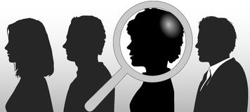 Magnifying Glass Chooses People in Row Royalty Free Stock Photography