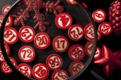 Magnifying glass and christmas bingo numbers Stock Photo