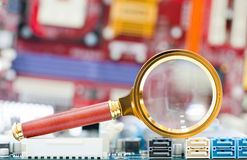 Magnifying glass and circuit board Royalty Free Stock Images