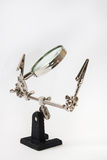 Magnifying glass with clamps Royalty Free Stock Image