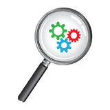 Magnifying glass with cogs Royalty Free Stock Images