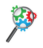 Magnifying glass with cogs Stock Images