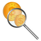 Magnifying glass with coins Royalty Free Stock Photo