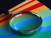 Magnifying glass on color paper