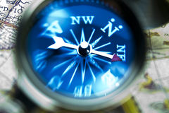 Magnifying glass & Compass Stock Photo