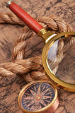 Magnifying glass and compass on the ancient map Royalty Free Stock Photography