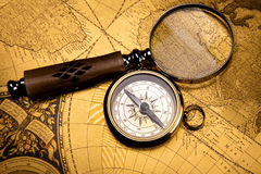 Magnifying glass & Compass, colorful bright journey theme Royalty Free Stock Photo