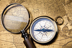 Magnifying glass & Compass, colorful bright journey theme Stock Photo