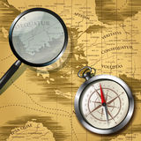 Magnifying glass and compass over old map. Magnifying glass and magnetic compass isolated on old map. Vector illustration Royalty Free Stock Photography