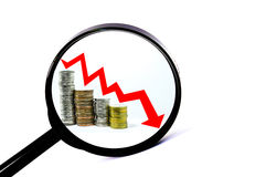 Magnifying glass concept red arrow downward. On coin stock photos