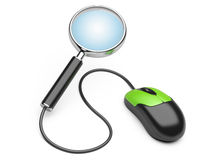 Magnifying glass connected to a computer mouse Royalty Free Stock Photo