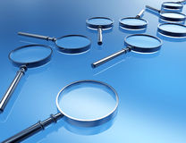 Magnifying glass. 3d magnifying glass in blue background Royalty Free Stock Image