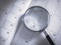Magnifying glass and diary Stock Images