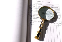 Magnifying glass on a document Stock Photo