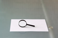 Magnifying glass with document Royalty Free Stock Photo