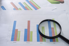 Magnifying glass and documents stock photos