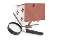 Magnifying glass with dummy of house Royalty Free Stock Images