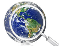 Magnifying glass on the earth Stock Photo