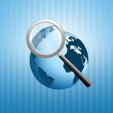 Magnifying glass with earth Royalty Free Stock Image