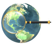 Magnifying glass on earth isolated Royalty Free Stock Photos