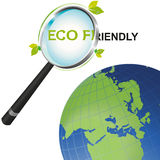 Magnifying glass Eco Friendly looking at the world Stock Image