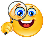 Magnifying glass emoticon. Emoticon holding a magnifying glass